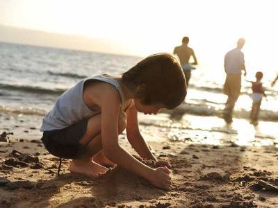 Little Boy Making Sandcastle